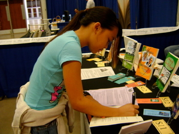 Jordon Reyes, juvenile author, signing a book at Book and Author Festival, 2009